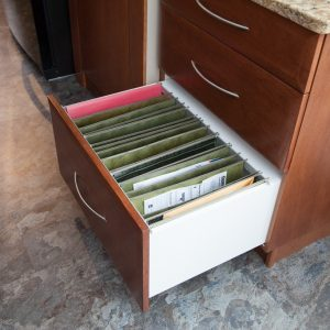 Filing drawer. Instead of piling them on a desk put them in one of these!