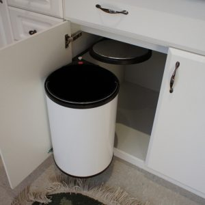 Swing out garbage with self closing lid. 20 Liter Capacity.